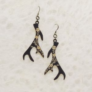 """These earrings are printed with an original illustration of an antler and cut out of sustainably-harvested birch wood veneer. They are 1/16"""" thick, 1 1/16"""" wide, and 2 1/4"""" tall without the hook. The hook is antique brass and lead- and nickel-free. Each piece of wood gives the design a unique character; the complexity of the grain brings the art to life and catches the light when it moves. Wood veneer is very sturdy so it holds up to the test of time – beautiful & practical."""